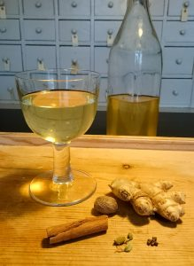 A glass of lutendrank and spices